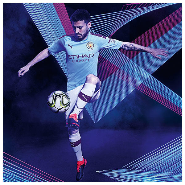 David Silva wears the 2019-20 Manchester City Home Kit