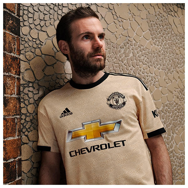 Juan Mata wears the 2019/20 Manchester United Away Kit